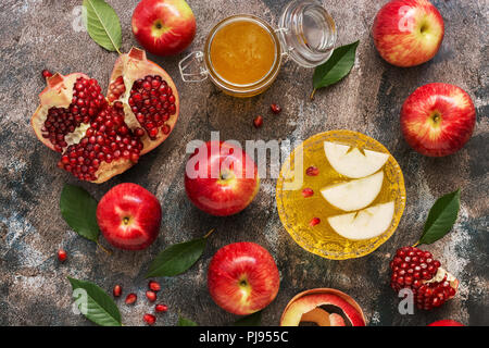 Red apples, pomegranate and honey. New Year - Rosh Hashana. Traditional Jewish food. Top view, overhead, flat lay - Stock Photo