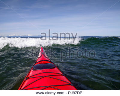 Surf kayaker's view of incoming breaking wave over bow, Puget Sound, Seattle, WA USA - Stock Photo