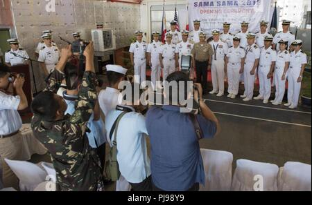 SAN FERNANDO CITY, Philippines (July 9, 2018) Exercise participants are photographed by media members during the opening ceremony of Maritime Training Activity (MTA) Sama Sama 2018. The week-long engagement focuses on the full spectrum of naval capabilities and is designed to strengthen the close partnership between both navies while cooperatively ensuring maritime security, stability and prosperity. - Stock Photo
