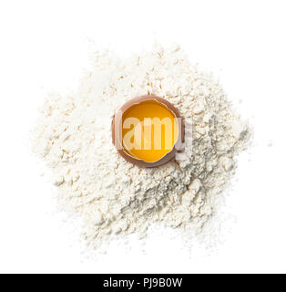 Fresh egg in wheat flour isolated on white background as package design element - Stock Photo