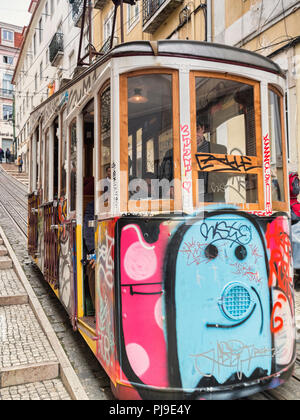 7 March 2018: Lisbon Portugal - The Bica Lift, or Elevador da Bica, decorated with graffiti, in the Misericordia district, a funicular railway line - Stock Photo