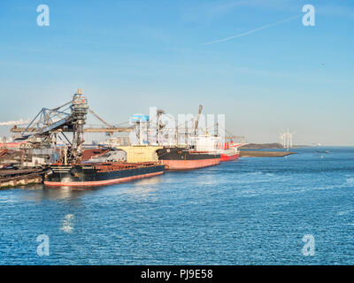 6 April 2018: Rotterdam, Netherlands - Bulk carriers Horizon 2 and Milos Warrior being loaded at Port of Rotterdam on a sunny spring morning with clea - Stock Photo