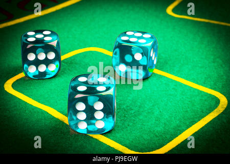 risk concept - playing dice on a green gaming table. Playing a game with dice. Blue casino dice rolls. Rolling the dice concept for business risk, cha - Stock Photo