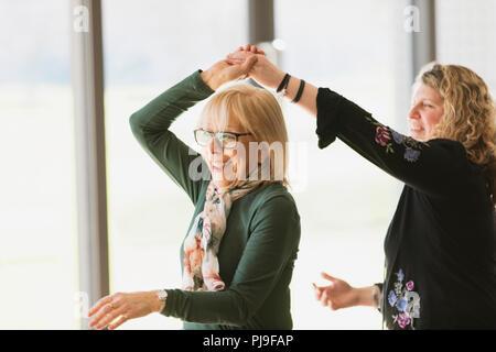 Smiling active senior woman dancing - Stock Photo