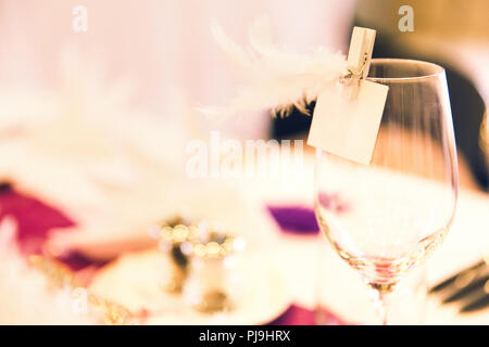 Wine Glass Feather Name Tag on Wedding Table - Stock Photo