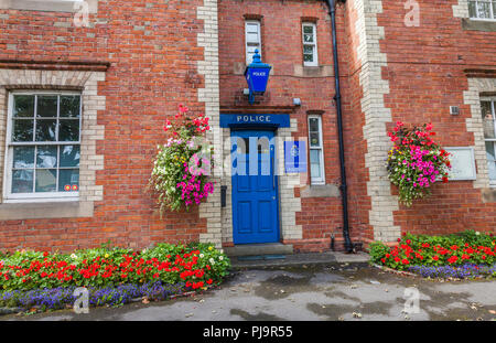 A rural Police Station at Sedgefield,Co.Durham,England,UK with a colourful display of flowers decorating the exterior - Stock Photo