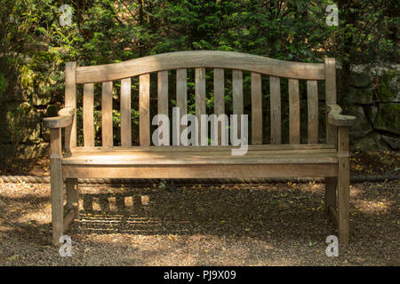 Hardwood Garden Bench Feature And Focal Point In An Inspirational Garden  Design. Handmade Outdoor Furniture Of Craftmanship As Ornament And To Be  Used Stock ...