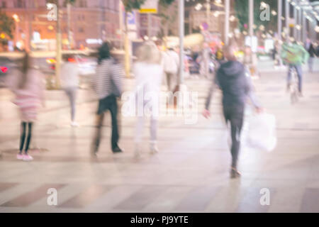Abstract bright blurred background with unidentified people, defocused motion, blurred background, city street. Concept of seasons, modern city, urban lifestyle, leisure - Stock Photo