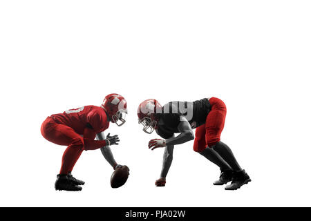 Active two american football player isolated on white background. Fit caucasian men in uniform with ball jumping over studio background in jump or motion. Human emotions and facial expressions concept. scramble concepts - Stock Photo