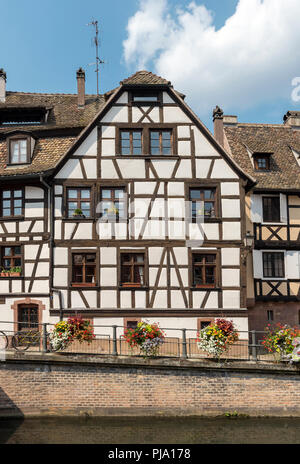 Timber-framed house on Quai des Moulins in La Petite France district of Strasbourg, France - Stock Photo