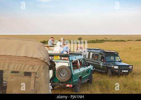 Game drive with tourists watching the wildlife on the savanna in Africa - Stock Photo