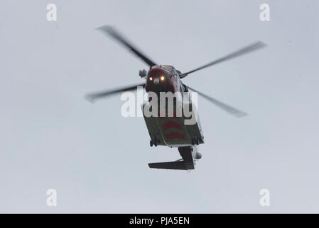 The Sikorsky S-92 HM Coastguard Helicopter leaving is Inverness Base for the Isle of Sky on the West Coast. - Stock Photo