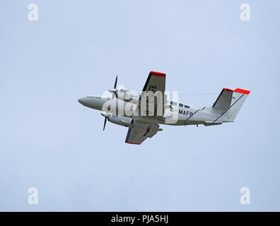 A marine & Fisheries Board twin engined aircraft leaving Inverness for a surveillance flight round the Orkney Isles to protect rising interests. - Stock Photo