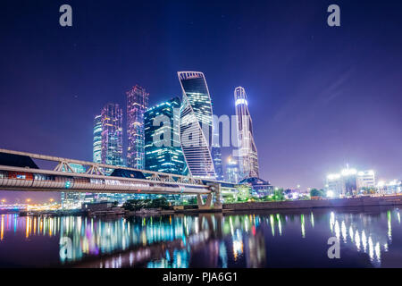 Moscow skyscrapers on the river-Moscow with night illumination of the city summer night - Stock Photo