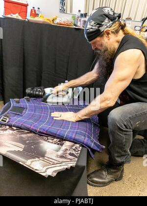Toronto, Ontario, Canada. 4th Sep, 2018. Metal guitarist, singer and songwriter ZAKK WYLDE ironing his kilt before Ozzy Osbourne show at Budweiser Stage in Toronto during 'No More Tours 2' tour. Credit: Igor Vidyashev/ZUMA Wire/Alamy Live News - Stock Photo