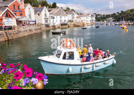 Fowey, Cornwall, U.K. 5th September 2018. Holidaymakers enjoy a boat trip on the River Fowey on a warm and sunny day in Cornwall. Credit: Mark Richardson/Alamy Live News - Stock Photo