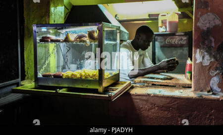 Nairobi, Kenya. 23rd Mar, 2018. A young man seen in his little shop along the streets of Kibera Slums.Kibera is one of Africa's largest Slums located in East Africa, Kenya. Credit: Donwilson Odhiambo/SOPA Images/ZUMA Wire/Alamy Live News - Stock Photo