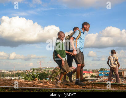 Nairobi, Kenya. 28th Mar, 2018. Boys seen heading back home after school in Kibera.Kibera is one of Africa's largest Slums located in East Africa, Kenya. Credit: Donwilson Odhiambo/SOPA Images/ZUMA Wire/Alamy Live News - Stock Photo
