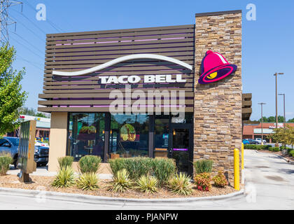 HICKORY, NC, USA-9/2/18: The front exterior of a Taco Bell restaurant in Hickory, NC, showing the drive-thru, and one pickup truck parked to the left. - Stock Photo