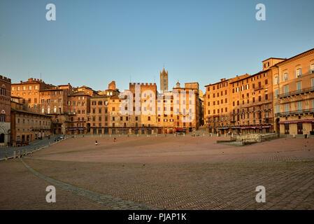 Italian square Piazza del Campo at the sunrise - Stock Photo