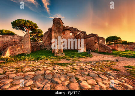 Sunset glimpse from cobblestones street in  Ancient Ostia ruins  - Rome