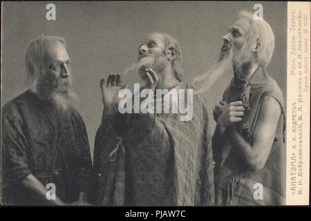 three old men talking in a group. vintage photo from a theatrical performance - Stock Photo