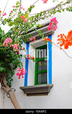 Beautiful Window in Puerto Mogan village with a lot of flowers around - Stock Photo