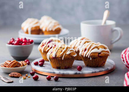 Muffins, cakes with cranberry and pecan nuts. Christmas decoration. - Stock Photo