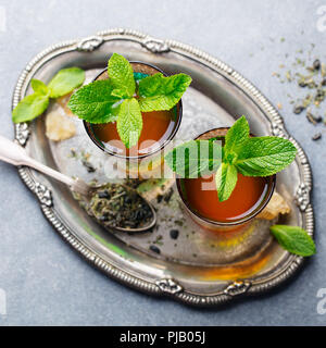 Mint tea, Moroccan traditional drink in glass. Top view. - Stock Photo