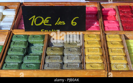 Colorful natural handmade French soap with lemon, tea and verbena scent in wooden boxes at a market in Marseille, Provence, France - Stock Photo