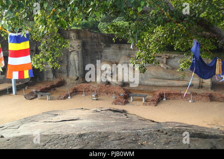 Big reclining Buddha statue in Polonnaruwa,Sri lanka - Stock Photo