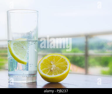 Glass of water with lemon. - Stock Photo