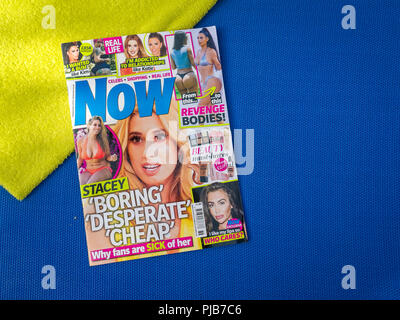 Copy of Now Magazine on a Sunbed, Now magazine is a weekly celebrity news round-up aimed at women readers, The magazine was launched in 1996. - Stock Photo