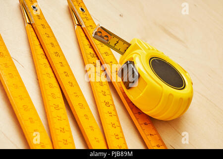background with ruler and tape measure on wooden board - Stock Photo