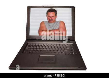 A laptop on the monitor a man with crossed arms. Concept Computer Crime - PC Security and Antivirus and Privacy. - Stock Photo