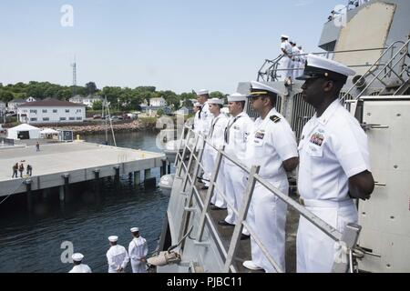 Maine (July 2, 2018) Sailors man the rails on the foc'sle of the Arleigh Burke class guided-missile destroyer USS McFaul (DDG 74) during a sea and anchor evolution. McFaul is currently conducting a port call in Eastport, Maine, to participate in the July 4th celebration. - Stock Photo