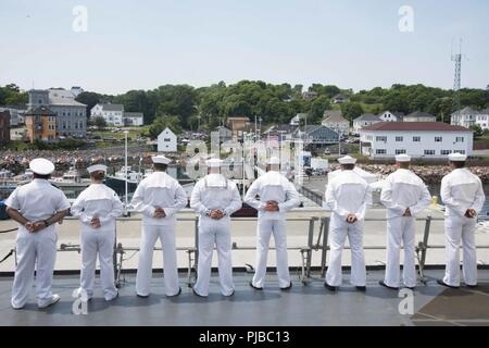 Maine (July 2, 2018) Sailors man the rails on the foc'sle of the Arleigh Burke class guided missile destroyer USS McFaul (DDG 74) during a sea and anchor evolution. McFaul is currently conducting a port call in Eastport, Maine, to participate in the July 4th celebration. - Stock Photo