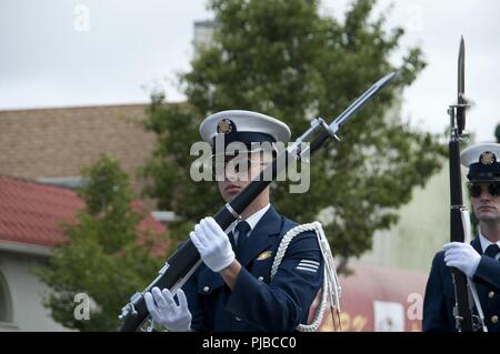 Members of the Coast Guard Ceremonial Honor Guard march in a Fourth of July parade in Alameda, California, a Coast Guard City, July 4, 2018. - Stock Photo