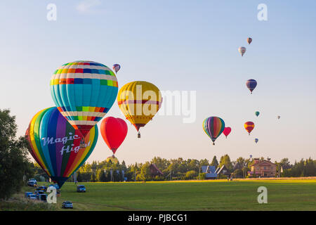 25.08.2018 - Dmitrov, Moscow Region, Russia. Preparation for colorful hot-air balloons flight over the forest - Stock Photo