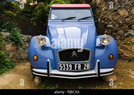 Blue Citroën 2CV car in Pigna, Corsica, France - Stock Photo