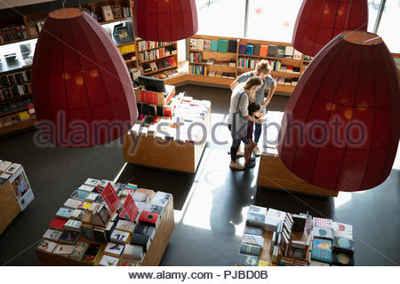 Family shopping in bookstore - Stock Photo