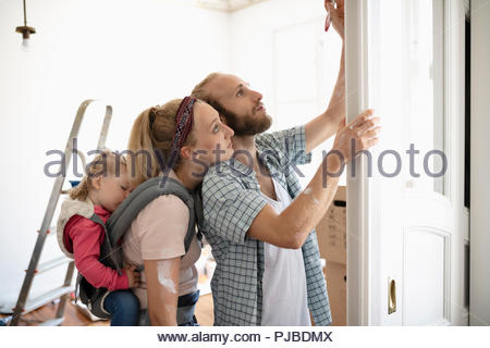 Affectionate young family painting - Stock Photo