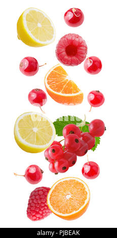 Flying fruits. Falling orange and red barries isolated on white background with clipping path as package design element and advertising. Floating frui - Stock Photo