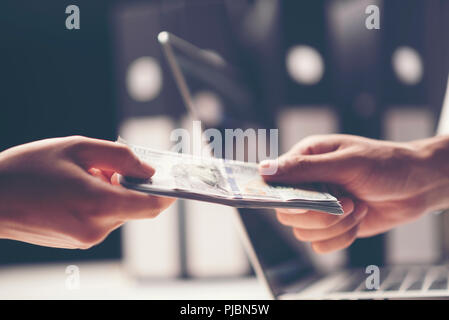 Close-up Of Person Hand Giving Money To Other Hand - Stock Photo