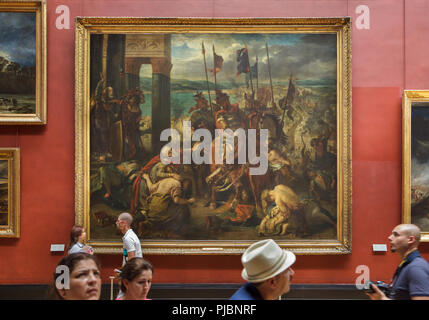 Visitors in front of the painting 'The Capture of Constantinople by the Crusaders', also known as 'The Entry of the Crusaders into Constantinople on 12 April 1204' by French Romantic painter Eugène Delacroix (1840) displayed at his retrospective exhibition in the Louvre Museum in Paris, France. The exhibition presenting the masterpieces of the leader of French Romanticism runs till 23 July 2018. - Stock Photo