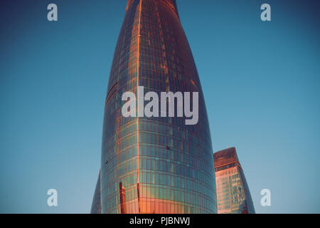 BAKU, AZERBAIJAN : Image of Baku Flame Towers. Best tourist city. City view of the Baku Flame towers, Azerbaijan. Lovely background picture of silhouette towers in sunset evening view - Stock Photo
