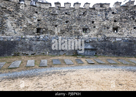 Fortified medieval church of the Templars situated in the french Pyrénées mountains, it's graveyard containing Knights of the Templars. - Stock Photo