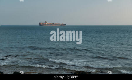 A large, ocean-going oil tanker ship as seen from the coast. - Stock Photo