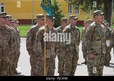 Yavoriv, Ukraine - Class 703-2018 Basic Leadership Course instructed by 7th Army Training Command non-commissioned officers complete a graduation ceremony at the Yavoriv Combat Training Center (CTC) July 11. 40 Soldiers of the 27th Infantry Brigade Combat Team (forward) were awarded and congratulated by their instructors, peers, and foreign military members. - Stock Photo