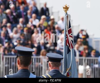 Members of the Royal Air Force march past distinguished visitors of the 2018 Royal International Air Tattoo at RAF Fairford, United Kingdom on July 13, 2018. This year's RIAT celebrated the 100th anniversary of the RAF and highlighted the United States' ever-strong alliance with the UK. - Stock Photo